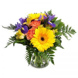 Festlig bukett med blandade blommor i gult, blått och orange.