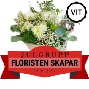 Floristen-skapar-julgrupp med vita blommor. Skicka julblommor med bud via Florister i Sverige!