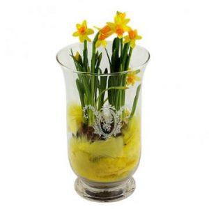Påskliljor arrangerade i glasvas. Beställ online hos Florister i Sverige